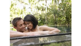 young-couple-relaxing-in-swimming-pool_1896087_grid.jpg